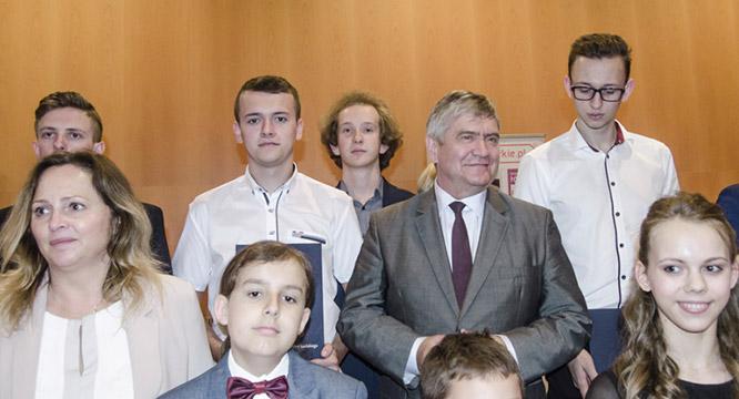 Uroczyste wręczenie stypendiów naukowych dla Tomasza Olszowiaka iMariusza Myszora